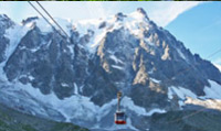 Travel on an Aiguille du Midi cable car; the  highest vertical ascent cable car in the world.