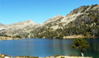 Travel past Aumar lake in Hautes-Pyrenees.