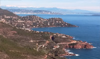 Travel along Corniche de l'Esterel; a small, yet spectacular cliff road  overlooking the Mediterranean.