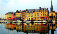 The Port of Honfleur is well-known for its old,  picturesque painted houses.