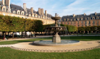 Travel to the Place des Vosges; one of the most beautiful and serene in Paris.